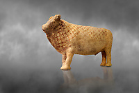 Minoan bull shaped rhython libation vessel decorated with a net pattern , Pseira  1500-1400 BC BC, Heraklion Archaeological  Museum, grey background.<br /> <br /> The net pattern over the bull and its cut horns signify that it is a wild bull intended for sacrifice.