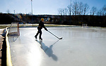 NAUGATUCK, CT-122717JS06----Brian Parzyck, 16, of Naugatuck braved Thursday's freezing temperatures and works on his hockey skills at the town ice rink at Breen Field in Naugatuck. The rink opened for the season on Thursday. <br />  Jim Shannon Republican-American