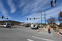 NWA Democrat-Gazette/J.T. WAMPLER A crew from Traffic Lighting Systems replaces a signal pole after transferring the traffic signal and cameras Monday Dec. 2, 2019 at the corner of Leroy Pond Dr. And Razorback Rd.