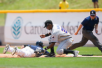 First baseman Michel Abreu #28 of the Buffalo Bison slaps a tag on Eider Torres #3 of the Charlotte Knights at Knights Castle June 22, 2009 in Fort Mill, South Carolina. (Photo by Brian Westerholt / Four Seam Images)