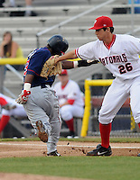 July 17, 2009: Pitcher Tom Milone (26) of the Potomac Nationals tags out Lucas Montero (33) in a rundown in a game against the Kinston Indians at G. Richard Pfitzner Stadium in Woodbridge, Va. Photo by:  Tom Priddy/Four Seam Images