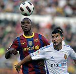 FC Barcelona's Eric Abidal (l) and Real Zaragoza's Braulio Nobrega during La Liga match.October 23,2010. (ALTERPHOTOS/Acero)