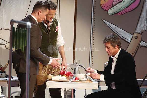 Andreas Gabalier, host Markus Lanz and Hugh Grant attending the German ZDF show &quot;Bet it&quot; (Wetten, dass...) at cityhall in Graz, Austria. 08.11.2014.<br /> Photo by M. Mann/insight media /MediaPunch ***FOR USA ONLY***