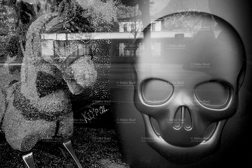 """Switzerland. Canton Ticino. Lugano. Shop window. A horse and a plastic skull for sale. Due to the spread of the coronavirus , the Federal Council has categorised the situation in the country as """"extraordinary"""". It has issued a recommendation to all citizens to stay at home, especially the sick and the elderly. From March 16 the government ramped up its response to the widening pandemic, ordering the closure of bars, restaurants, sports facilities and cultural spaces. Only businesses providing essential goods to the population – such as grocery stores, bakeries and pharmacies – are to remain open. 3.04.2020 © 2020 Didier Ruef"""