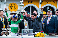 BALTIMORE, MD - MAY 21: Exaggerator jockey Kent J. Desormeaux (L) and trainer Keith Desormeaux (R) hold the trophy after winning the 141st running of the Preakness Stakes at Pimlico Race Course on May 21, 2016 in Baltimore, Maryland. (Photo by Sue Kawczynski/Eclipse Sportswire/Getty Images)