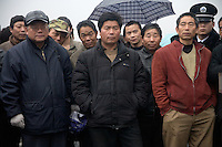 Men wait outside the Memorial Hall of the Nanjing Massacre in Nanjing, Jiangsu, China, on Dec. 13, 2009.  On Dec. 13, 2009, thousands of people visited The Memorial Hall of the Nanjing Massacre in Nanjing, Jiangsu, China, to remember those who died at the hands of Japanese soldiers in 1937-8.  The day marked the 72nd anniversary of the start of the massacre. The historical account has always been mired in controversy, and differing opinions on what actually happened have been a consistent obstacle to relations between China and Japan.  China's official account of history states that 300,000 people were killed by Japanese forces over a 6-week period starting Dec. 13, 1937