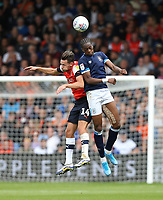 Huddersfield Town's Terence Kongolo and Luton Town's Harry Cornick<br /> <br /> Photographer Rob Newell/CameraSport<br /> <br /> The EFL Sky Bet Championship - Luton Town v Huddersfield Town - Saturday 31 August 2019 - Kenilworth Stadium - Luton<br /> <br /> World Copyright © 2019 CameraSport. All rights reserved. 43 Linden Ave. Countesthorpe. Leicester. England. LE8 5PG - Tel: +44 (0) 116 277 4147 - admin@camerasport.com - www.camerasport.com