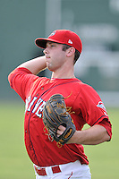 Pitcher Ben Taylor (32) of the Greenville Drive warms up before a game against the Charleston RiverDogs on Friday, August 14, 2015, at Fluor Field at the West End in Greenville, South Carolina. Taylor was selected by the Boston Red Sox in the 7th round of the 2015 First-Year Player Draft out of the University of South Alabama. Charleston won, 6-2. (Tom Priddy/Four Seam Images)