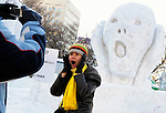 A visitor mimics a sculpture depicting Edvard Munch's The Scream during the snow and ice festival in Sapporo City, northern Japan. About 2 million people visit the city to see the hundreds of hand-crafted snow and ice sculptures that have graced the Sapporo Snow Festival since its inception in 1950.