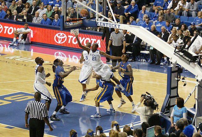 Kentucky forward Perry Stevenson trips over Morehead State guard as he attemps a layup during the second half of the game at Rupp Arena Friday night..Photo by Zach Brake | Staff.