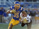 BROOKINGS, SD - NOVEMBER 5:  Isaac Wallace #35 from South Dakota State slips past Skyler Hulse #33 form Missouri State in the first half Saturday afternoon at Dana J. Dykhouse Stadium in Brookings. (Photo by Dave Eggen/Inertia)