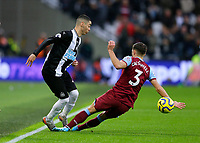 2nd November 2019; London Stadium, London, England; English Premier League Football, West Ham United versus Newcastle United; Aaron Cresswell of West Ham United slide tackles Miguel Almiron of Newcastle United - Strictly Editorial Use Only. No use with unauthorized audio, video, data, fixture lists, club/league logos or 'live' services. Online in-match use limited to 120 images, no video emulation. No use in betting, games or single club/league/player publications
