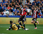 Leon Clarke of Sheffield Utd scores his second goal past Keiren Westwood of Sheffield Wednesday during the Championship match at the Hillsborough Stadium, Sheffield. Picture date 24th September 2017. Picture credit should read: Simon Bellis/Sportimage