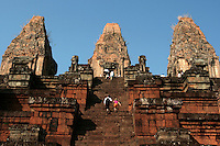 "Pre Rup is a temple at Angkor, Cambodia, built as the state temple of King Rajendravarman and dedicated in 961 or 962. It is a temple mountain of combined brick, laterite and sandstone construction.  Pre Rup was dedicated to the Hindu god Shiva. Its extensive laterite and brick give it a pleasing reddish tone that is heightened by early morning and late afternoon sunlight.  The temple's name is a comparatively modern one meaning ""turn the body."" This reflects the common belief among Cambodians that funerals were conducted at the temple, with the ashes of the body being ritually rotated in different directions as the service progressed."