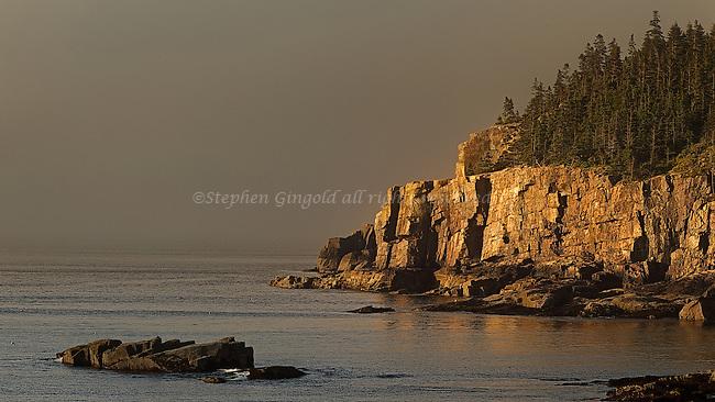 Early morning light hits Otter Cliffs at Acadia National Park.