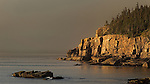 Early morning light hits Otter Cliffs at Acadia National Park.