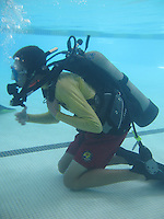 The Plunge Swimming Pool, Mission Beach, San Diego CA, USA.  August 6 2013:  A San Diego Junior Lifeguard participates in an introcuction to SCUBA Diving.  More than 60 San Diego Junior Lifeguards particiapted in a PADI Discover Scuba Diving Program hosted by the San Diego Junior Lifeguard Foundation.  Over the course of the summer more than 220 Junior Guards were introduced to SCUBA.