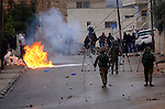 Israeli security forces take position during clashes with Palestinian protesters next to the Jewish settlement of Psagot, near the West Bank city of Ramallah, November 3, 2015. The current wave of violence erupted in mid-September, fueled by rumors that Israel was trying to increase Jewish presence in Jerusalem then quickly spread across Israel, the West Bank and the Gaza Strip. Photo by Shadi Hatem