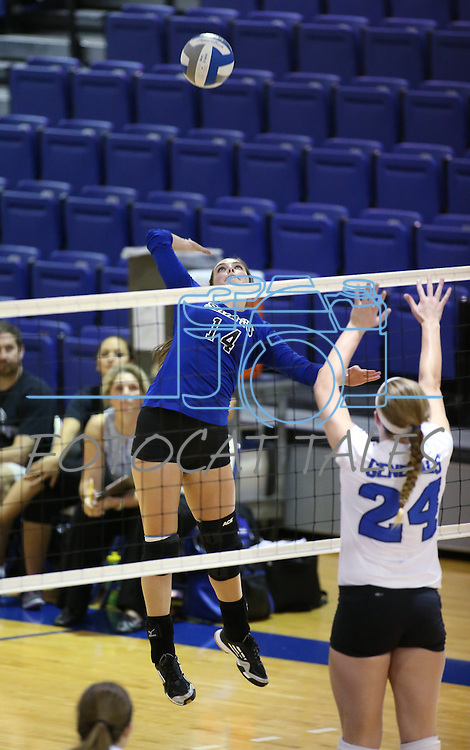 Marymount's Erin Allison hits during a college volleyball match at Washington & Lee University Lexington, Vir., on Saturday, Oct. 5, 2013.<br /> Photo by Cathleen Allison