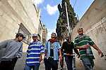 Palestinian and European-Palestinian Hip Hop artists walk in Askar refugee camp, near Nablus, West Bank.