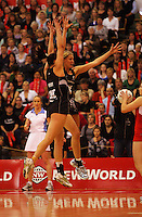 Joline Henry and Casey Williams leap to block during the New World International Netball Series between the NZ Silver Ferns and England at Arena Manawatu, Palmerston North, New Zealand on Wednesday, 18 October 2008. Photo: Dave Lintott / lintottphoto.co.nz