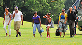 United States President Barack Obama and his family return to the South Lawn of the White House in Washington, D.C. from a weekend at Camp David, the presidential retreat near Thurmont, Maryland. From left to right: Malia Obama; Avery Robinson (the Obamas' nephew); Roxanne Nesbitt (daughter of family friends, Marty Nesbitt and Anita Blanchard); Sasha Obama; first lady Michelle Obama; and President Obama..Credit: Ron Sachs / Pool via CNP