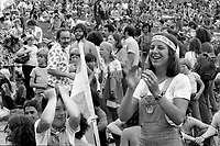 June 25, 1976 File Photo -  Montreal, Quebec. CANADA -  <br />  Despite the rain over 100 000 people stay for the third day of the Quebec National Holliday celebration and to listen to artist such as  Jean Lapointe, Louise Forestier and Plume Latraverse  Held on the Mount-Royal the 4 day event attracted a record 300 000 people on June, 23rd and his considered a peak in Quebec nationalist movement, only  a few months before the Parti Quebecois election on November 15, 1976.