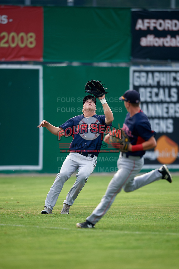 Lowell Spinners left fielder Tyler Esplin (40) catches a fly ball as shortstop Grant Williams (right) looks on during a game against the Batavia Muckdogs on July 16, 2018 at Dwyer Stadium in Batavia, New York.  Lowell defeated Batavia 4-3.  (Mike Janes/Four Seam Images)