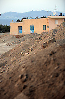 Pictured: Mounts of rubble and soil left at the farmhouse (TOP) site where Ben Needham disappeared from in Kos, Greece. <br />Re: The search for missing Ben Needham led by South Yorkshire Police has concluded on the Greek island of Kos.<br />Ben, from Sheffield, was 21 months old when he disappeared on 24 July 1991 during a family holiday.<br />Digging took place around the farmhouse where Ben Needham was last seen and at a new site after a fresh line of inquiry suggested he could have been crushed by a digger.