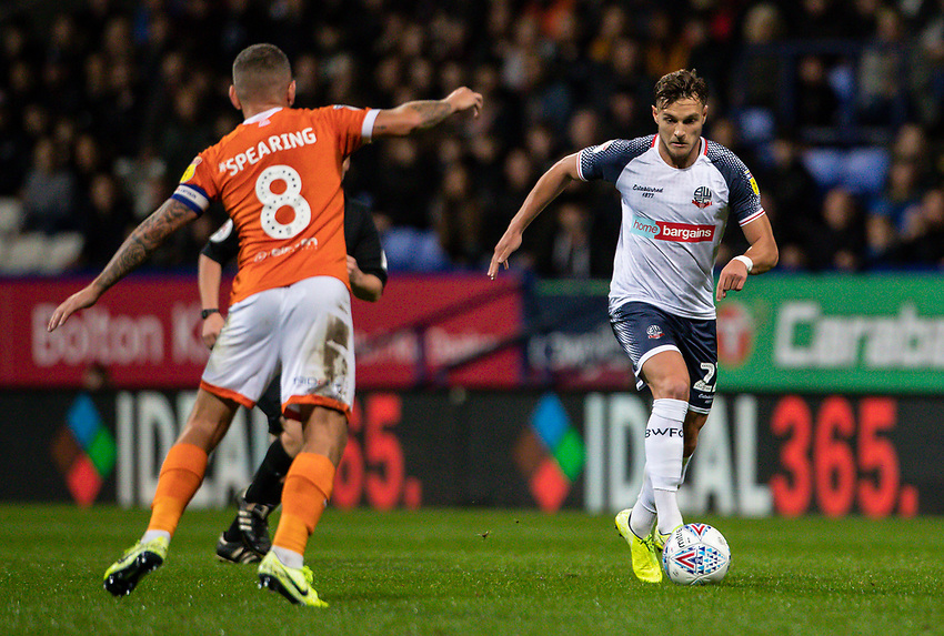 Bolton Wanderers' Dennis Politic breaks under pressure from Blackpool's Jay Spearing (left) <br /> <br /> Photographer Andrew Kearns/CameraSport<br /> <br /> The EFL Sky Bet League One - Bolton Wanderers v Blackpool - Monday 7th October 2019 - University of Bolton Stadium - Bolton<br /> <br /> World Copyright © 2019 CameraSport. All rights reserved. 43 Linden Ave. Countesthorpe. Leicester. England. LE8 5PG - Tel: +44 (0) 116 277 4147 - admin@camerasport.com - www.camerasport.com
