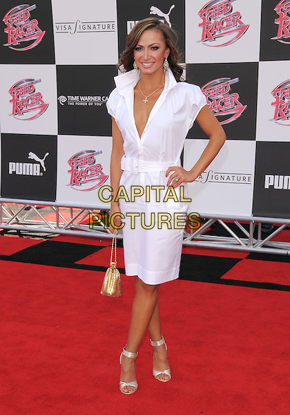"KARINA SMIRNOFF.Attending The Warner Brothers Pictures World Premiere of ""Speed Racer"" held at The Nokia Theatre in Los Angeles, California, USA, April 26th 2008.                                                                     full length white shirt dress hand on hip gold bag shoes ankle strap sandals.CAP/DVS.©Debbie VanStory/Capital Pictures"