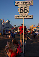 The unofficial end of Route 66 on The Santa Monica Pier.  The pier is  located at the foot of Colorado Avenue in Santa Monica, California and is a prominent, 100-year-old landmark. The pier contains Pacific Park, a family amusement park with a large Ferris wheel.<br /> <br /> the current Santa Monica Pier is actually two adjoining piers that long had separate owners. The long, narrow Municipal Pier opened September 9, 1909, primarily to carry sewer pipes beyond the breakers, and had no amenities. The short, wide adjoining Pleasure Pier to the south, a.k.a. Newcomb Pier, was built in 1916 by Charles I. D. Looff and his son Arthur, amusement park pioneers.