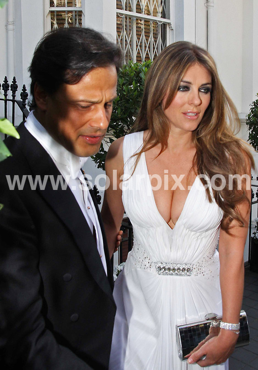 **ALL ROUND PICTURES FROM SOLARPIX.COM**.**WORLDWIDE SYNDICATION RIGHTS**.Liz Hurley leaves her house with Arun Nayar, on her way to Elton John's White Tie and Tiara Ball, Windsor. 25 June 2009..JOB REF: 9338   LNJ       DATE:  25.06.09.**MUST CREDIT SOLARPIX.COM OR DOUBLE FEE WILL BE CHARGED**.**ONLINE USAGE FEE  GBP 50.00 PER PICTURE - NOTIFICATION OF USAGE TO PHOTO @ SOLARPIX.COM**.**CALL SOLARPIX : +34 952 811 768 or LOW RATE FROM UK 0844 617 7637**