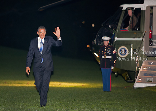 "United States President Barack Obama returns to the South Lawn of the White House following a day-trip to Miami, Florida where he attended campaign events, in Washington, Thursday, October 11, 2012. When asked by a reporter how he thought the vice president did in his debate this evening, the president responded, ""I thought Joe Biden did great; I couldn't be prouder""..Credit: Martin Simon / Pool via CNP"