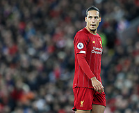 2nd January 2020; Anfield, Liverpool, Merseyside, England; English Premier League Football, Liverpool versus Sheffield United; Virgil van Dijk of Liverpool looks on as Sheffield United win a corner kick - Strictly Editorial Use Only. No use with unauthorized audio, video, data, fixture lists, club/league logos or 'live' services. Online in-match use limited to 120 images, no video emulation. No use in betting, games or single club/league/player publications
