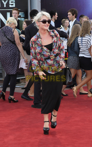 JAIME WINSTONE.UK Premiere of 'Cowboys and Aliens' at the Cineworld cinema at the O2 Arena, London, England..August 11th 2011.full length black leggings platform shoes mary janes red blue beige print floral top sunglasses shades  .CAP/ROS.©Steve Ross/Capital Pictures