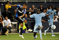 Jason Hernadez (black) San Jose Earthquakes defender clears the ball past Kei Kamara Sporting KC... Sporting KC defeated San Jose Earthquakes 1-0 at LIVESTRONG Sporting Park, Kansas City, Kansas.