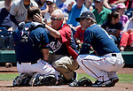 Reno Aces trainer, Joe Metz, center,  and manager Butler, right, look at Ed Easley after he was hit by a pitch that deflected off the batters helmet in their game against the Tacoma Rainiers played on Sunday afternoon, May 26, 2013 in Reno, Nevada.