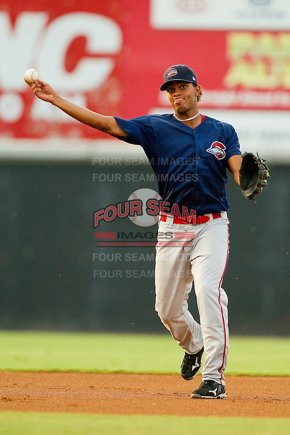 Shortstop Xander Bogaerts #23 of the Greenville Drive makes a throw to first base against the Hickory Crawdads at L.P. Frans Stadium on September 3, 2011 in Hickory, North Carolina.  The Crawdads defeated the Drive 3-0.  (Brian Westerholt / Four Seam Images)