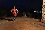 06/06/14. Goktapa, Iraq. Dhuha posing as a fashion model.