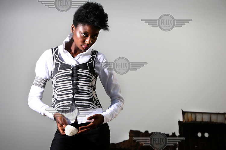 Model Uju wears designs created by local fashion designer Bimpe Adebambo during a photo shoot in Lagos.