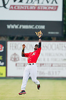 Kannapolis Intimidators shortstop Tim Anderson (2) catches a fly ball in shallow center field during the South Atlantic League game against the Delmarva Shorebirds at CMC-Northeast Stadium on August 8, 2013 in Kannapolis, North Carolina.  The Shorebirds defeated the Intimidators 4-3.  (Brian Westerholt/Four Seam Images)