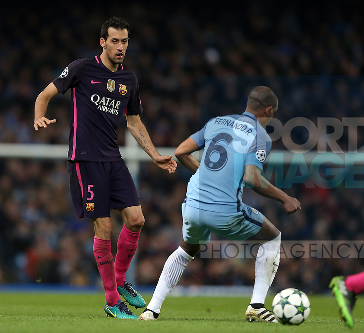 Sergio Busquets of Barcelona and Fernando of Manchester City during the Champions League Group C match at the Etihad Stadium, Manchester. Picture date: November 1st, 2016. Pic Simon Bellis/Sportimage