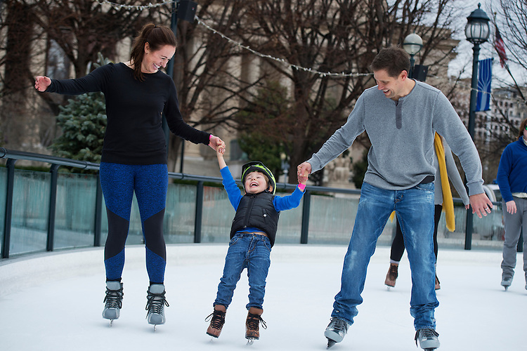 UNITED STATES - DECEMBER 14: Rich and Christyne Brennan of Capitol Hill, skate with their son Aiden, 4, around the National Gallery of Art Sculpture Garden Ice Rink, December 14, 2015. (Photo By Tom Williams/CQ Roll Call)