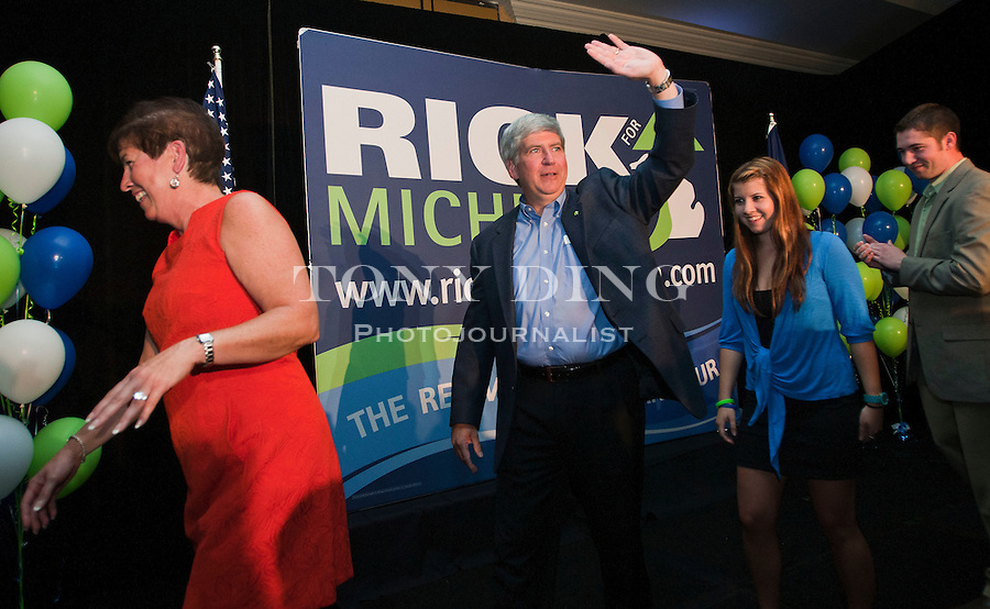 Michigan Republican gubernatorial candidate Rick Snyder, center, waves to supporters at his election-night event after the day's primary election, Tuesday, Aug. 3, 2010, in Ypsilanti, Mich. Snyder edged out Michigan Attorney General Mike Cox and U.S. Congressman Pete Hoekstra to face Democratic nominee, and Lansing, Mich. Mayor Virg Bernero, in the November general election. (AP Photo/Tony Ding)