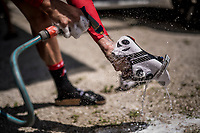 Julien Bernard (FRA/Trek-Segafredo) cleaning his racing shoes after the restday 3 training ride with Team Trek-Segafredo<br /> <br /> 100th Giro d'Italia 2017