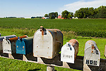 Mail boxes in row, farm with red barn, Lake Lillian, Minnesota