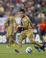 Philadelphia Union midfielder Roger Torres (20) slips a pass through. The Philadelphia Union defeated New England Revolution, 2-1, at Gillette Stadium on August 28, 2010.