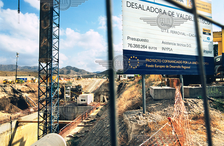A building notice stands on the construction site of a water desalination factory funded by the European Union (EU). In recent years there has been an explosion of controversial tourist-focused developments in Spain's arid southeastern region causing environmental degradation and placing enormous pressure on the limited water supplies in the area.