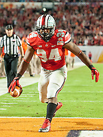 January 3, 2014 - Miami Gardens, Florida, U.S: Ohio State Buckeyes running back Carlos Hyde (34) runs in for a touch down during second half action of the Discover Orange Bowl between the Clemson Tigers and the Ohio State Buckeyes. Clemson defeated Ohio State 40-35 at Sun Life Stadium in Miami Gardens, Fl